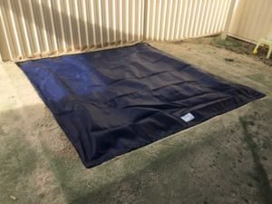 Sandpit cover with chain in hem