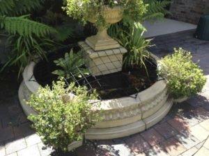 Pond Safety Net on ornamental fountain