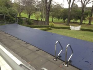 Leaf cover on wet edge pool with ladder