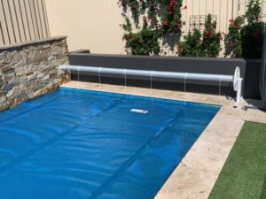 benefits of swimming pool covers