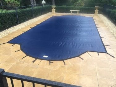 does a heated pool need a cover