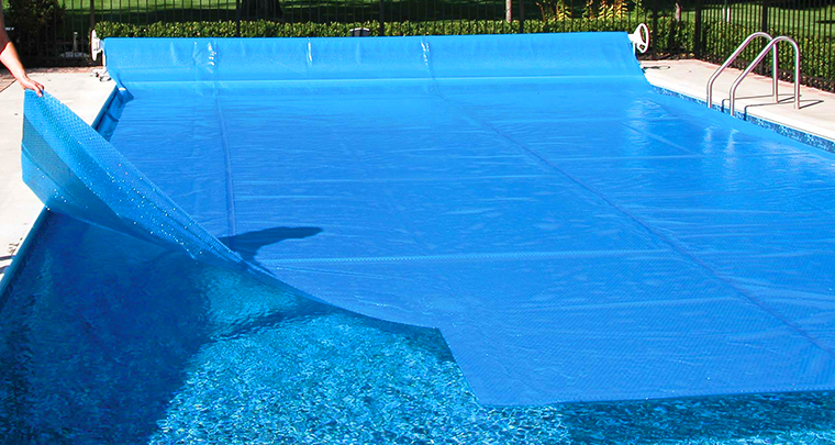 a solar cover helps extend your pool season